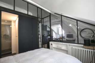 furnished studio with mezzanine and glazed partition in Paris