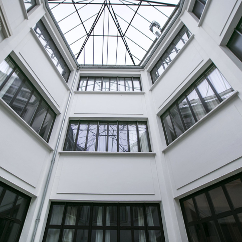 large bay windows atrium Paris building
