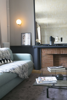 brick and marble chimney Paris style apartment