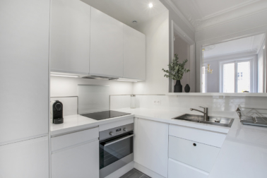 white light grey equipped kitchen furnished apartment Paris 7th