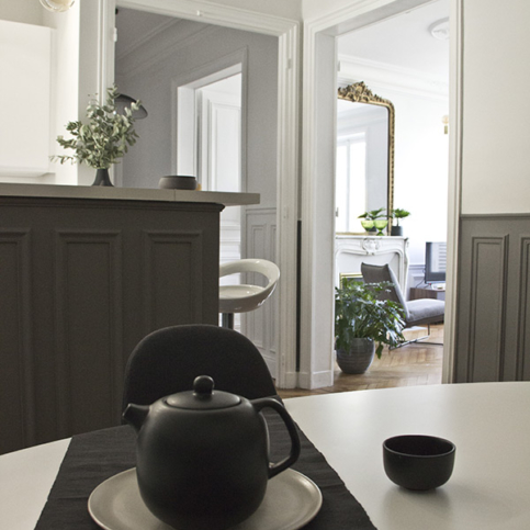 light-filled equipped kitchen black white grey furnished rental in Paris