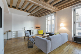 furnished apartment with exposed wooden beams parquet flooring Paris