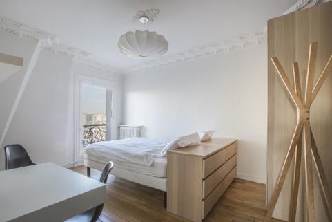 guest bedroom double bed parquet flooring Paris rental