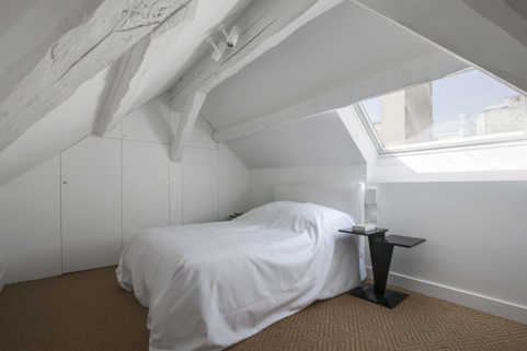 Bedroom with view over the roofs of Paris rental