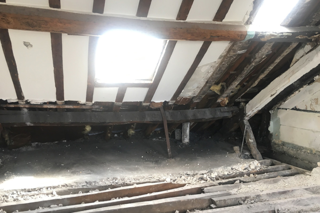 sloped ceiling exposed beams furnished apartment Paris