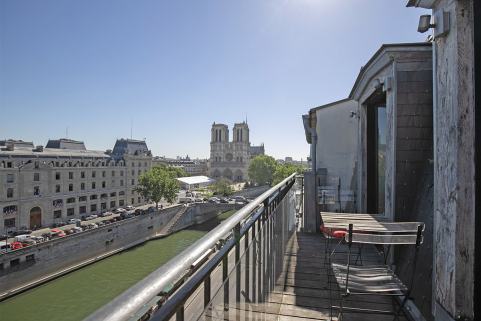 Furnished apartment with balcony view of Seine and Notre-Dame Paris