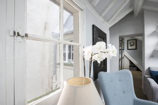 one-bedroom apartment in Paris exposed beams Saint-Germain-des-Prés