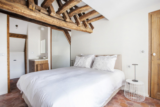 furnished apartment bedroom exposed beams Paris