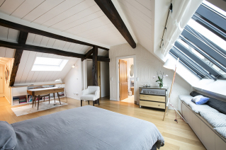 rent an apartment Paris under the eaves exposed beams