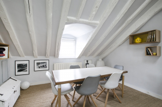 Rue de Grenelle furnished rental apartment with beams dining area