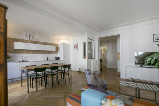 Live in Paris furnished rental kitchen opens on liviing
