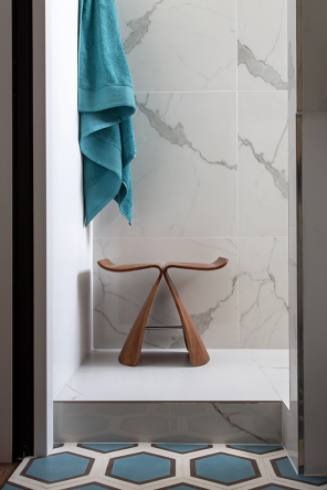 A little wooden stool in the renovated bathroom