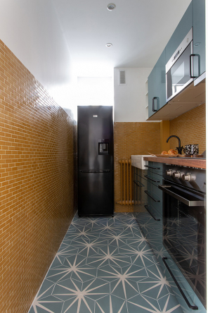 The vintage yellow backsplash in the kitchen was kept