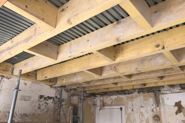 Before/after: timber load-bearing beams