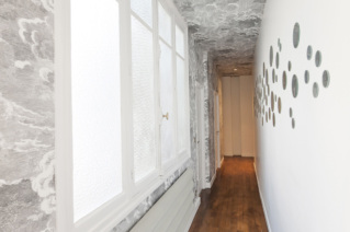 Long corridor in a furnished Haussmanian apartment