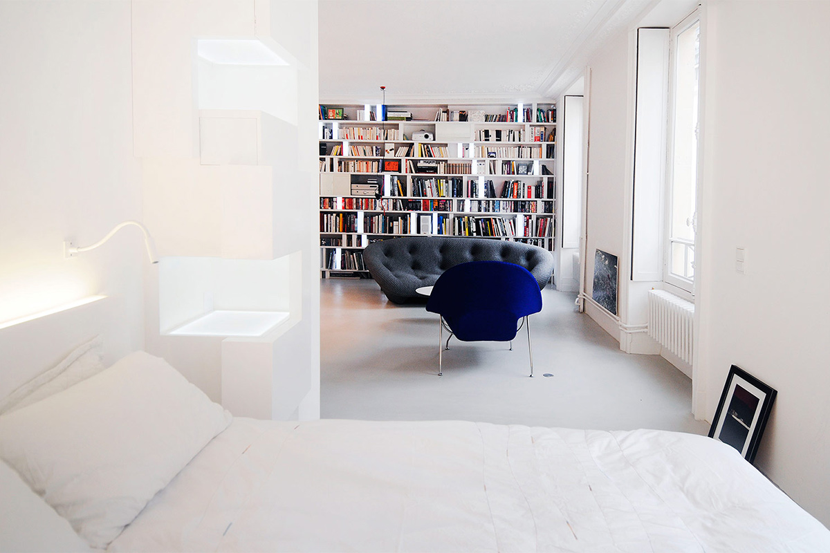 Paris Apartment with one bedroom. The bedside table is designed as a sculpture.