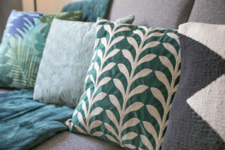 Mix and match colours and textures - A sofa in a living room