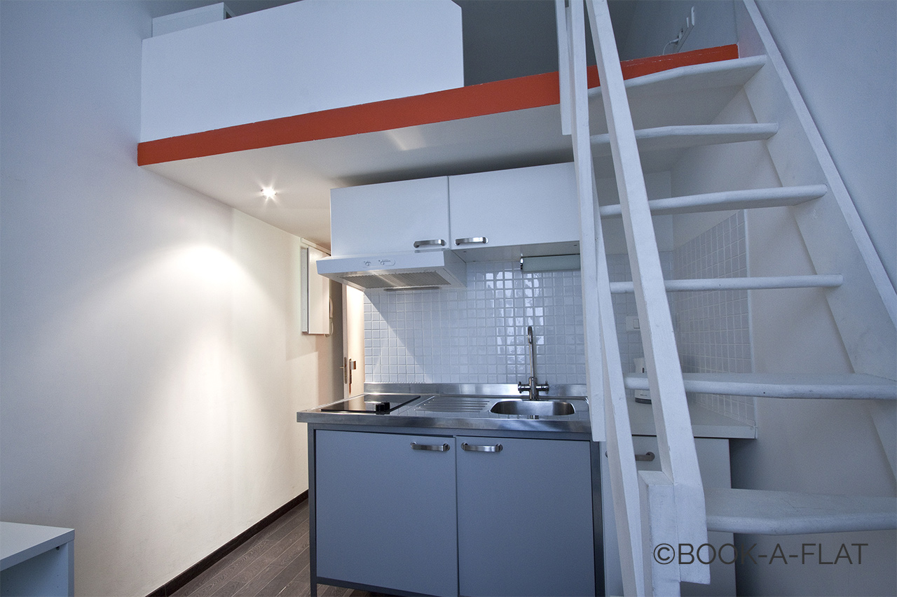 Equipped kitchenette and stairs leading to the mezzanine