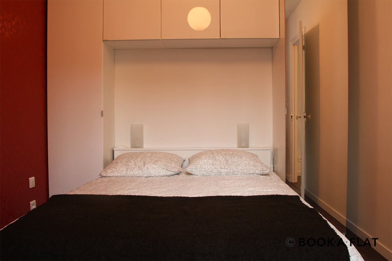 Bedroom with double bed and storage