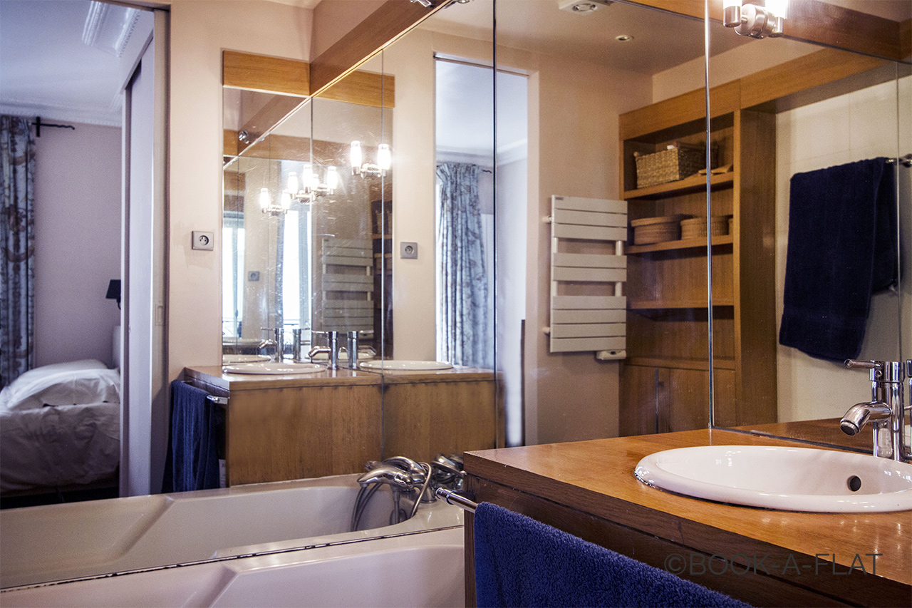 Bathroom with a sink and a bathtub